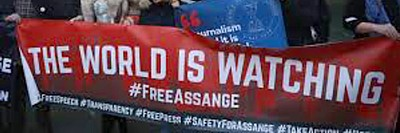 Julian Assange the world is watching Banner